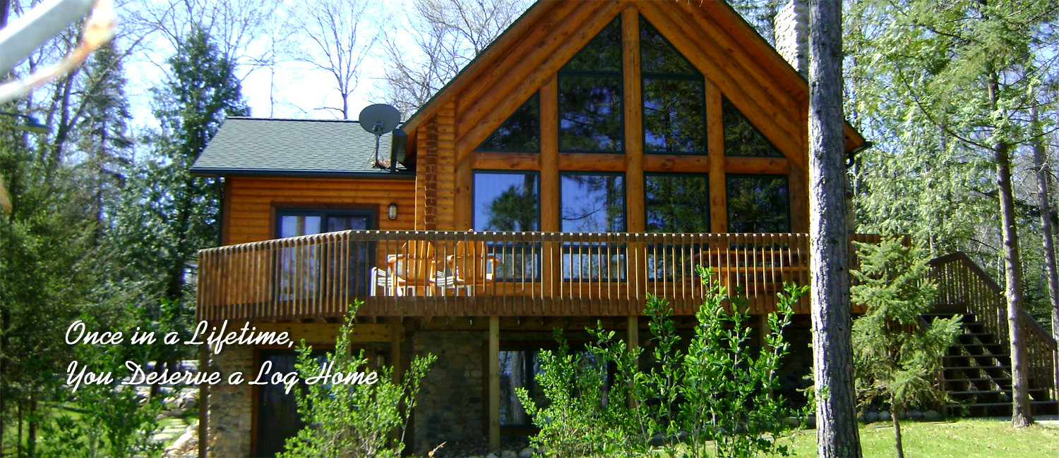Exterior of a beautiful custom log home with a wall of windows