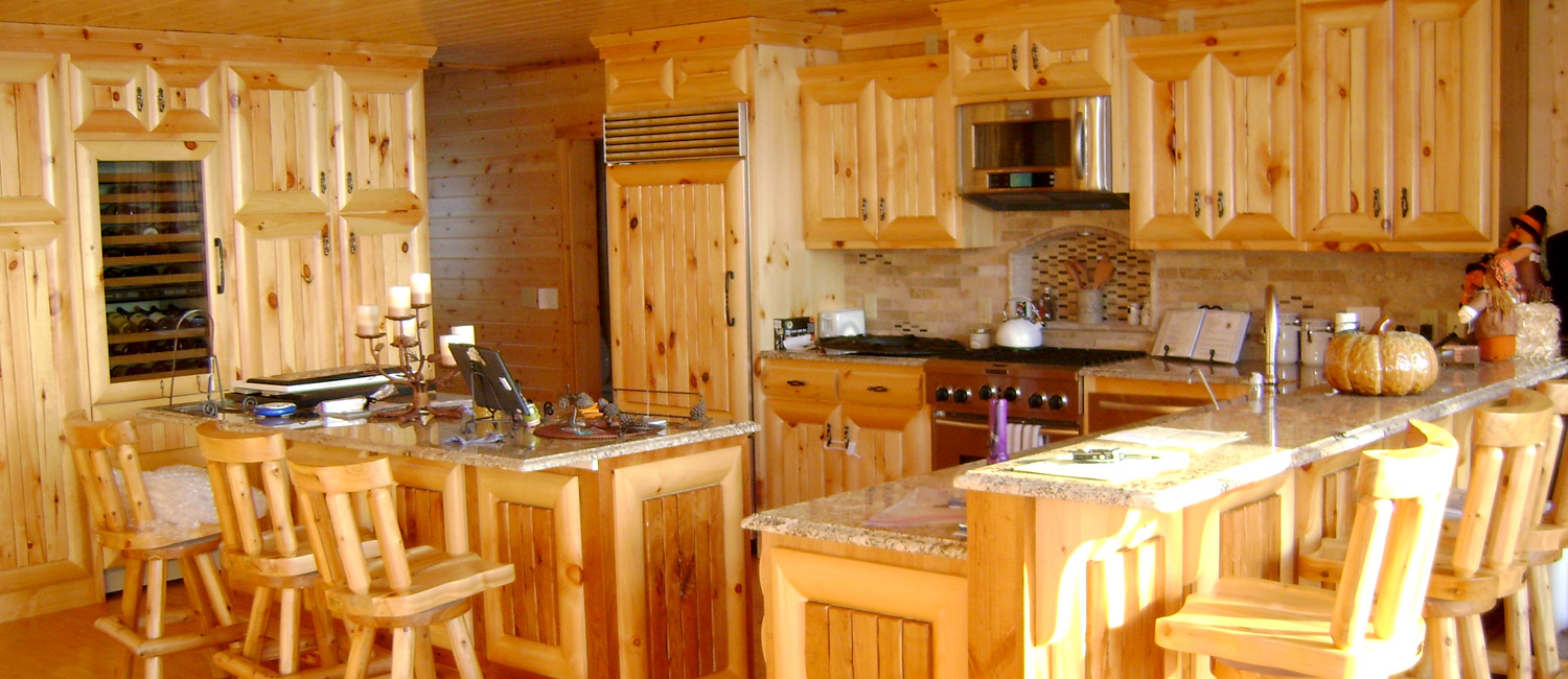 Log home kitchen with cedar cabinets and granite countertops